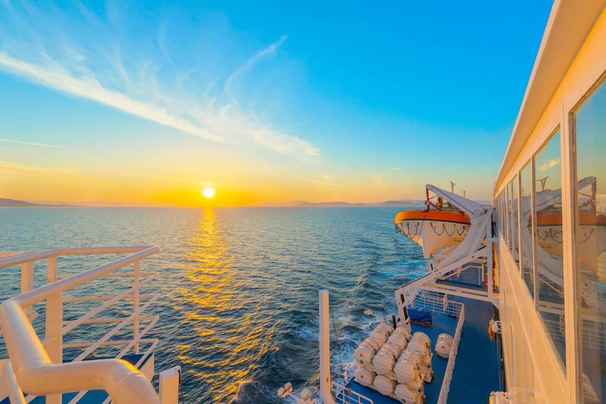 Sunset from ship at Mediterranean Sea during tour in Greece to Greek Islands