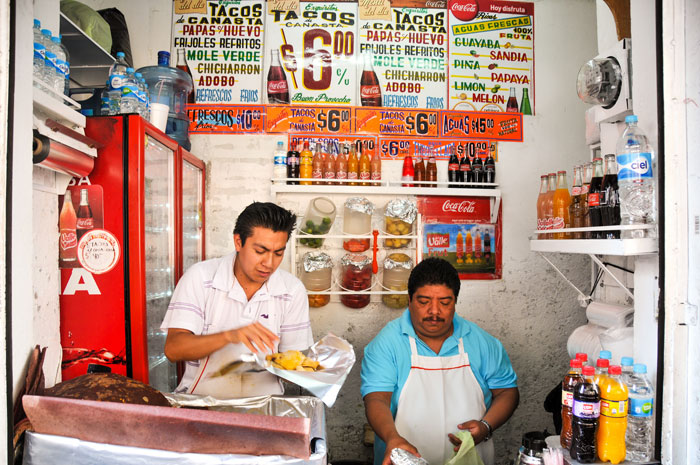 Eating tacos in Mexico. Flickr creative commons credit: Joshua Bousel