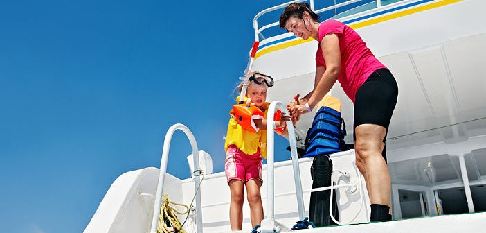 Happy family with child on yacht.