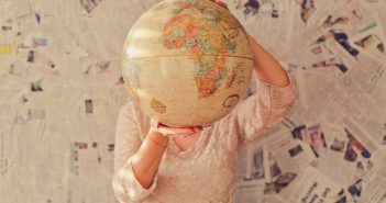 Girl with atlas