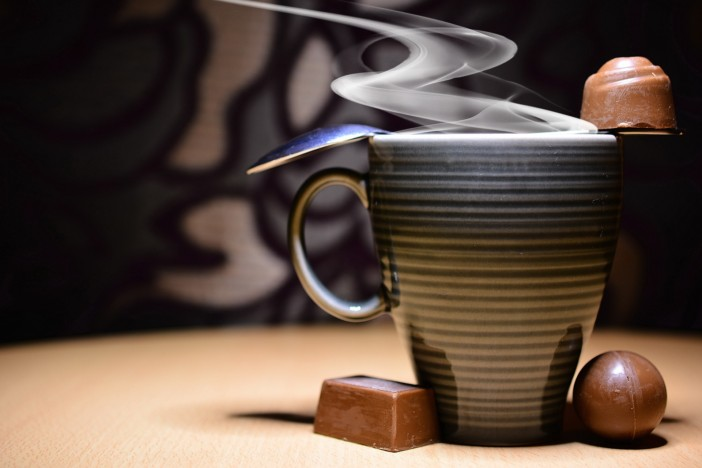 A mug of steaming hot Arabic coffee.