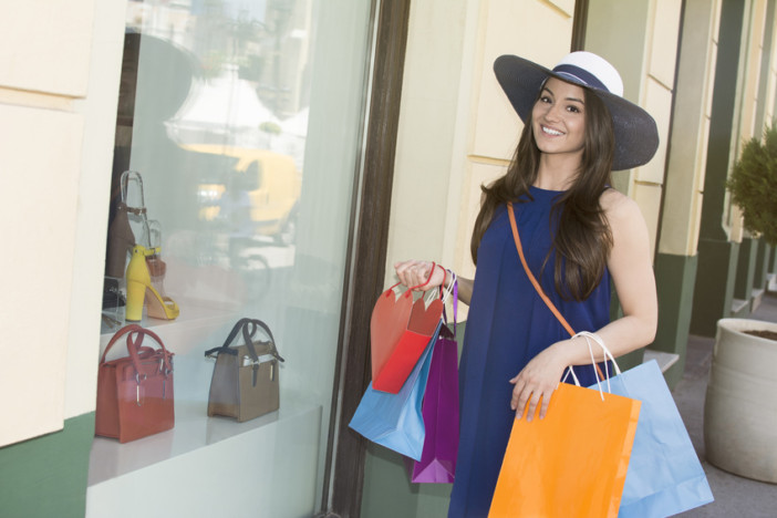 cheerful young lady happy with her purchases in uae