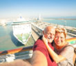 Senior happy couple taking selfie on cruise ship. Active retired people having fun