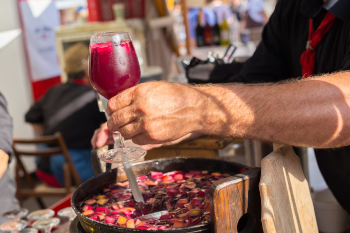 Refreshing sangria with fruits being served on urban street food stall.