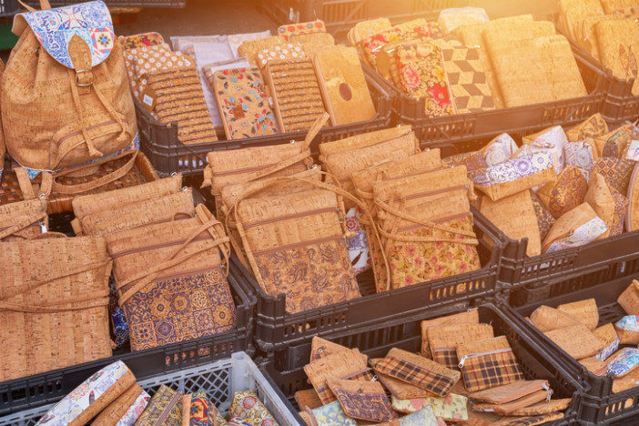 Traditional souvenirs from cork, bags on the market, Porto, Portugal