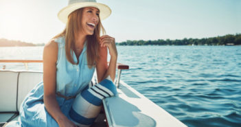 Shot of an attractive young woman spending the day on her private yacht