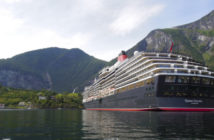 Flam, Norway - August 6, 2012: MS Queen Victoria moored in the town of Flam in the Aurerlandsfjord in Norway. The MS Queen victoria is a cruise ship operated by the Cunard Line