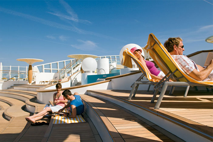 People relaxing on deck of a ship