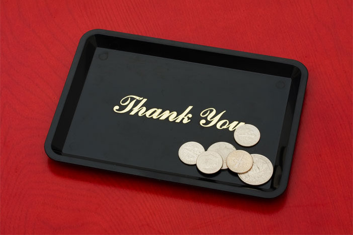 Coin in a thank you inscribed tray