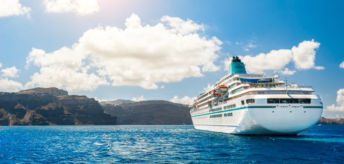 cruise ship with mountains in background